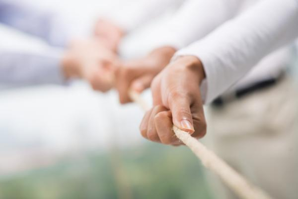 tug-of-war in business