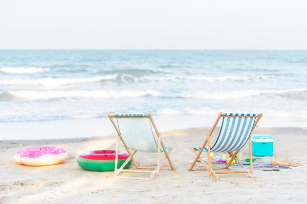 beach chairs and floaties by the ocean