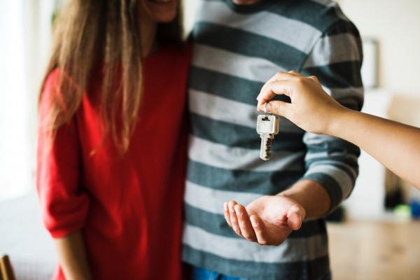 first time homebuyers receiving keys to their new home